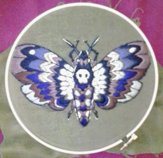 embroidered deaths head moth